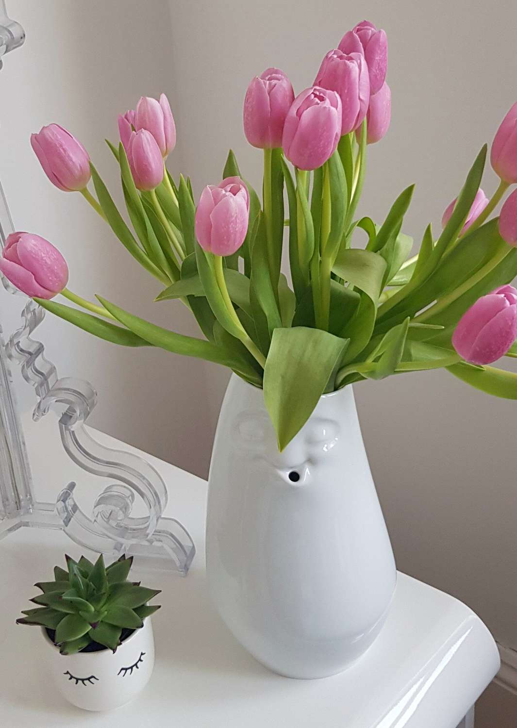 White porcelain vase with smiley face