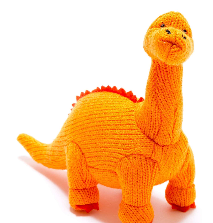 Orange diplodocus dinosaur baby rattle