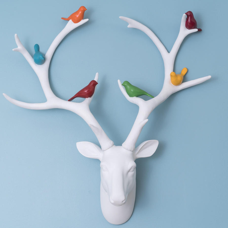 White contemporary deer trophy head with coloured birds