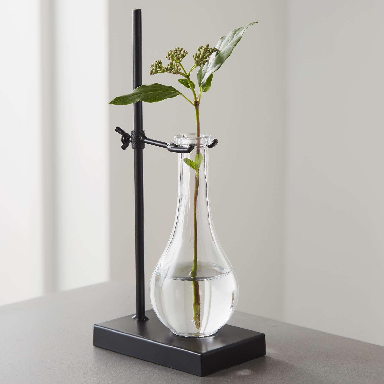 Lab flask glass vase on black metal stand