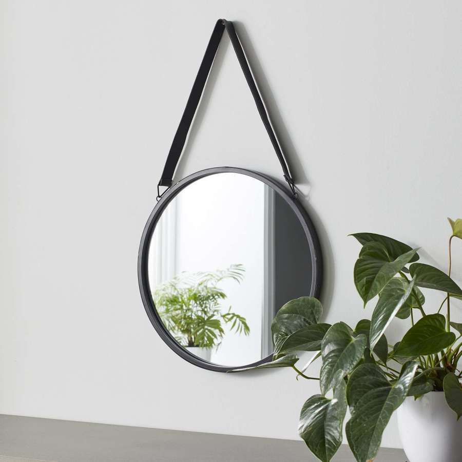 Round black metal mirror with leather strap