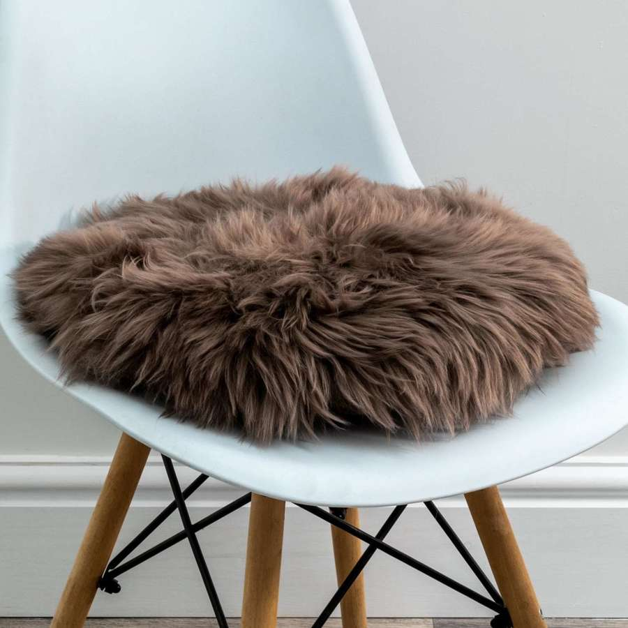 Taupe round sheepskin chair pad