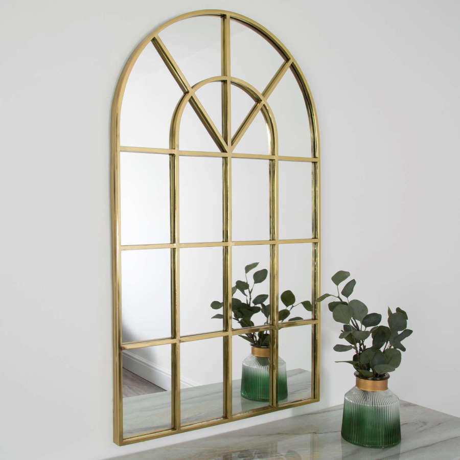 Gold metal arched windowpane mirror
